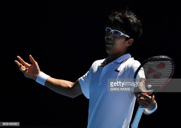 South Korea's Hyeon Chung reacts to a point against Tennys Sandgren of the US during their men's singles quarter-finals match on day 10 of the...