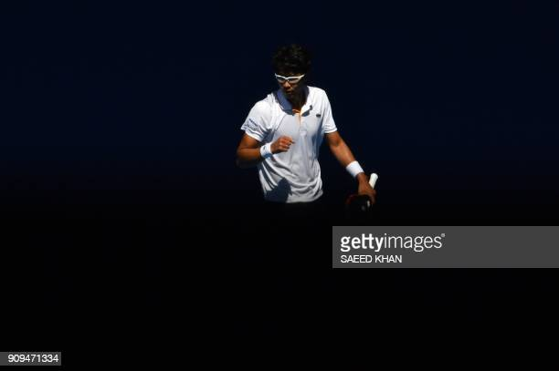 TOPSHOT South Korea's Hyeon Chung reacts to a point against Tennys Sandgren of the US during their men's singles quarterfinals match on day 10 of the...