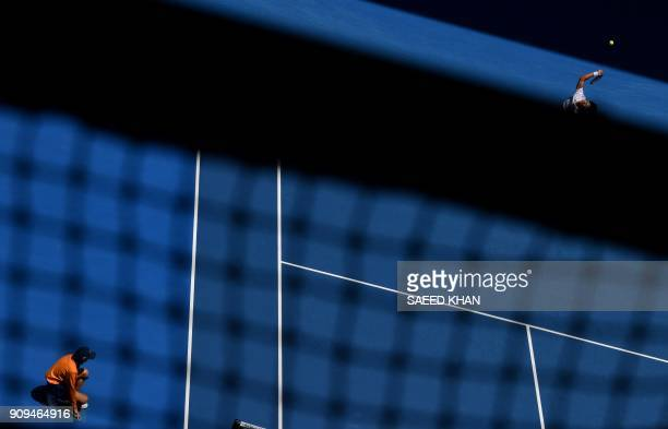TOPSHOT South Korea's Hyeon Chung serves against Tennys Sandgren of the US during their men's singles quarterfinals match on day 10 of the Australian...