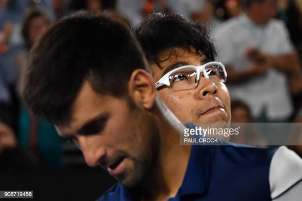 South Korea's Hyeon Chung smiles beside Serbia's Novak Djokovic after their men's singles fourth round match on day eight of the Australian Open...