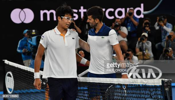 South Korea's Hyeon Chung speaks as he celebrates after victory over Serbia's Novak Djokovic after their men's singles fourth round match on day...