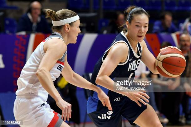 South Korea's Hyeyoon Bae drives the ball past Great Britain's Rachael Vanderwal during the FIBA Women's Olympic Qualifying basketball match between...