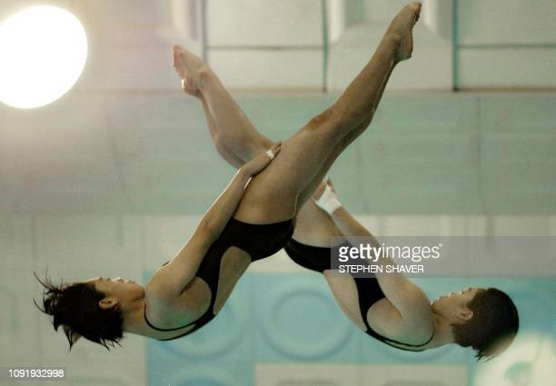 South Korea's Im SunYoung and Choi HyeJin perform in the women's synchronized diving finals 09 October 2002 during the 14th Asian Games in Busan...