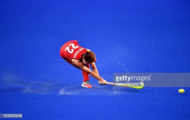 TOPSHOT South Korea's Jang Hee Sun hits the ball during the women's field hockey semifinal match between Japan and South Korea at the 2018 Asian...