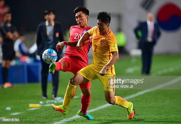 South Korea's Jang HyunSoo fights for the ball with China's Ren Hang during the World Cup 2018 football qualification match between South Korea and...