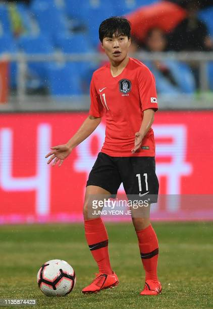 South Korea's Ji Soyun dribbles the ball against Iceland during a women's friendly football match in Chuncheon on April 9 2019