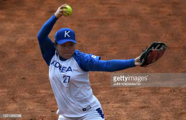 TOPSHOT South Korea's Jung Narae pitches during the women's preliminary softball match between Japan and South Korea at the 2018 Asian Games in...