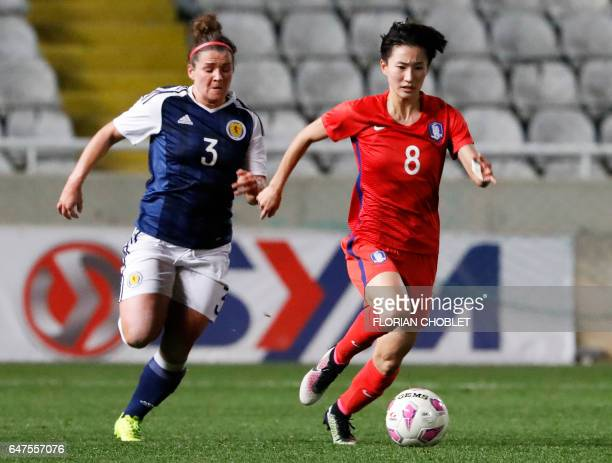 South Korea's Kang YuMi dribbles past Scotland's Emma Mitchell during the Cyprus Women's Cup football match between South Korea and Scotland on March...