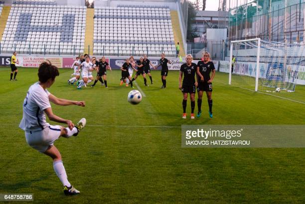 South Korea's Kang Yumi hits the ball towards New Zealand's players during the Cyprus Women's Cup football match between South Korea and New Zealand...