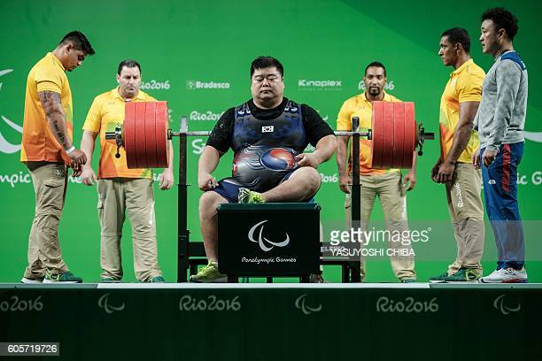 TOPSHOT South Korea's Keun Bae Chun concentrates during the men's powerlifting 107 kg at the Paralympic Games in the Riocentro in Rio de Janeiro...