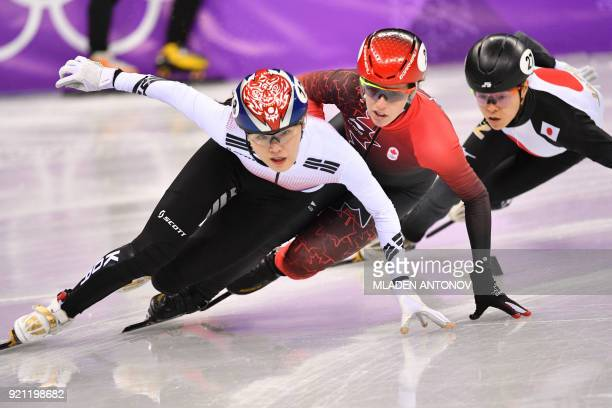 South Korea's Kim Alang leads ahead Canada's Marianne St Gelais and Japan's Sumire Kikuchi in the women's 1000m short track speed skating heat event...
