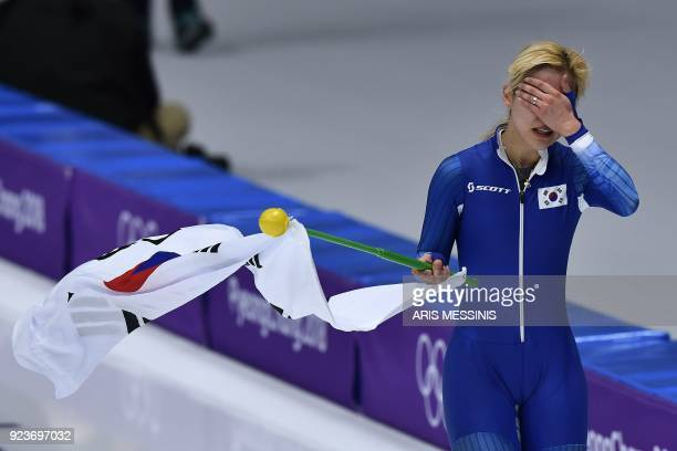 TOPSHOT South Korea's Kim BoReum celebrates after coming second in the women's mass start final speed skating event during the Pyeongchang 2018...