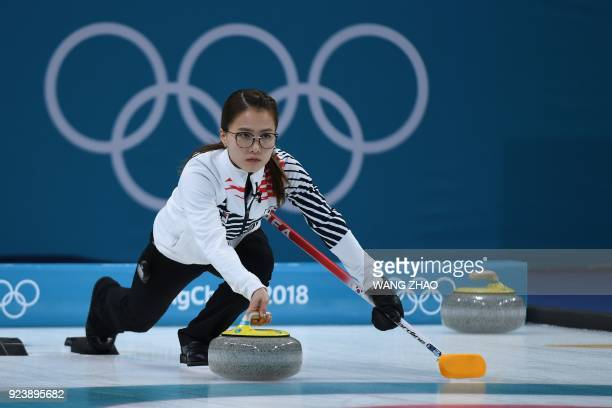 TOPSHOT South Korea's Kim Eunjung throws the stone during the curling women's gold medal game between South Korea and Sweden during the Pyeongchang...