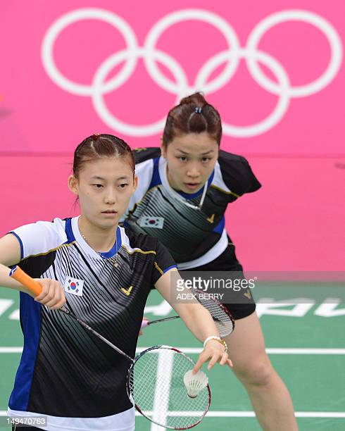 South Korea's Kim Ha Na serves a shuttle cock as Jung Kyung Eun looks on as they play against Canada's Alex Bruce and Li Michele during their women's...