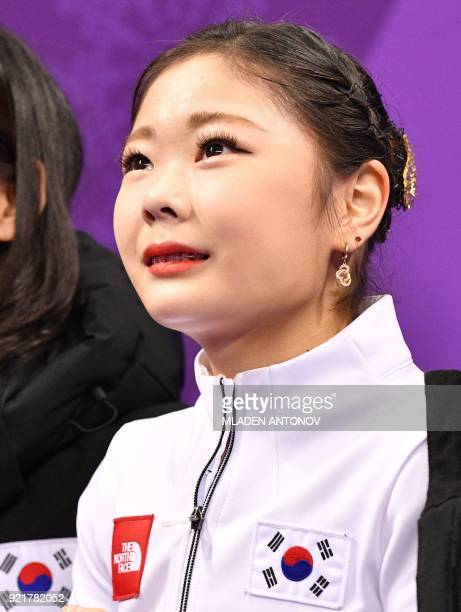 South Korea's Kim Hanul reacts after her performance in the women's single skating short program of the figure skating event during the Pyeongchang...
