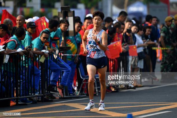 South Korea's Kim Hyunsub approaches the finish line in the men's 20km walk race competition during the 2018 Asian Games in Jakarta on August 29 2018