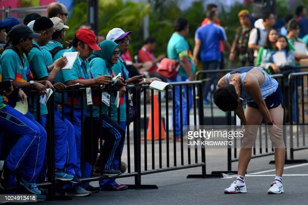 South Korea's Kim Hyunsub reacts after finishing the men's 20km walk race competition during the 2018 Asian Games in Jakarta on August 29 2018