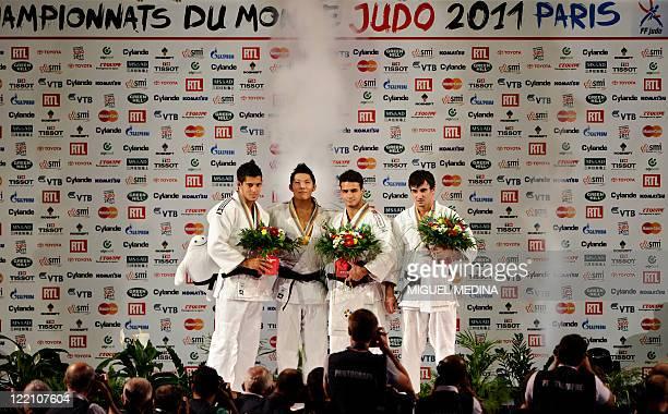 South Korea's Kim Jae-Bum celebrates with his gold medal next to Montenegro's Srdjan Mrvaljevic , Brazil's Leandro Guilheiro and Moldavia's Sergiu...