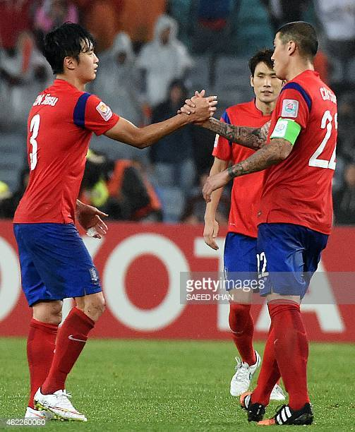 South Korea's Kim Jin Su and Cha Duri celebrate their victory against Iraq in the semifinal football match between South Korea and Iraq at the AFC...