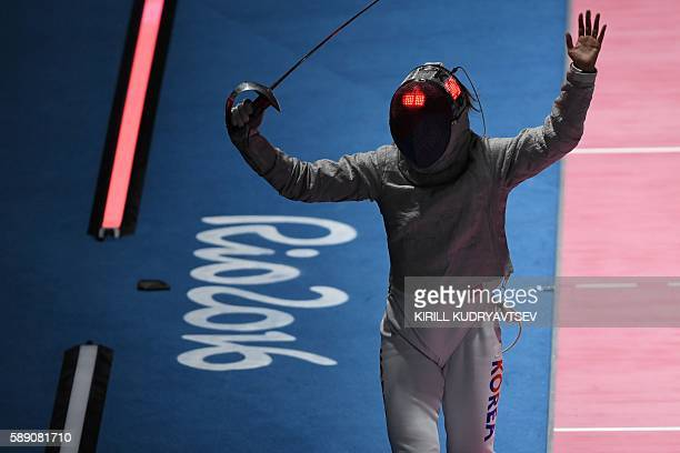 South Korea's Kim Jiyeon celebrates after winning the womens team sabre placement 56 bout between Poland and South Korea as part of the fencing event...