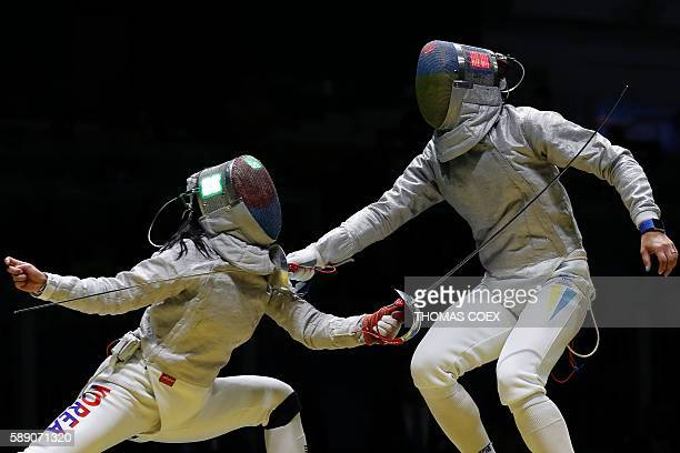 South Korea's Kim Jiyeon competes against Ukraine's Olena Kravatska during the womens team sabre quarterfinal bout between South Korea and Ukraine as...