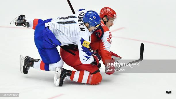 South Korea's Kim Kisung challenges for the puck with Denmark's Mikkel Boedker during the group B match Denmark vs Korea of the 2018 IIHF Ice Hockey...