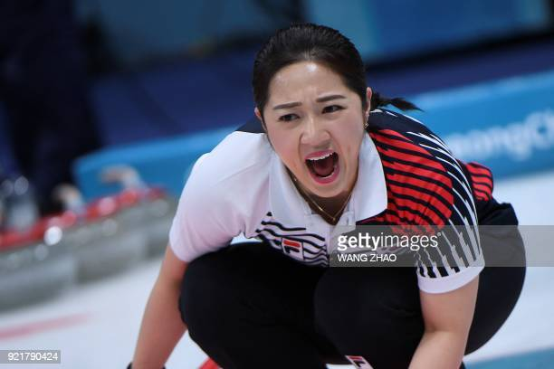 South Korea's Kim Kyeongae shouts during the curling women's round robin session between South Korea and the Olympic Athletes from Russia during the...