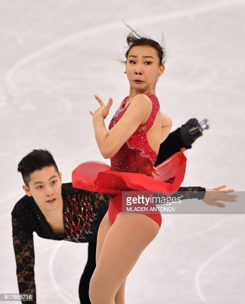 South Korea's Kim Kyueun and South Korea's Alex Kang Chan Kam compete in the pair skating short program of the figure skating event during the...