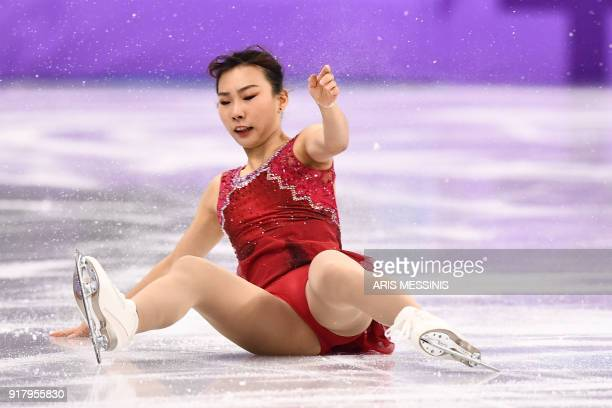 South Korea's Kim Kyueun falls on the ice as she competes with partner South Korea's Alex Kang Chan Kam in the pair skating short program of the...