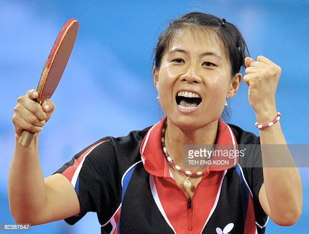 South Korea's Kim KyungAh celebrates after defeating Japan's Sayaka Hirano in their singles match part of the women's team table tennis bronze medal...