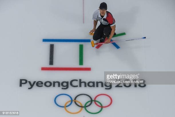 South Korea's Kim MinChan competes during the curling men's round robin session between South Korea and Sweden during the Pyeongchang 2018 Winter...