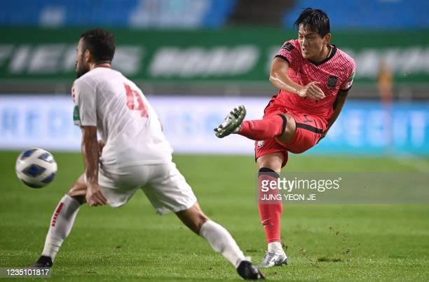 South Korea's Kim Min-jae takes a shot past Lebanon's Abbas Assi during the FIFA World Cup Qatar 2022 Asian qualification football match between...