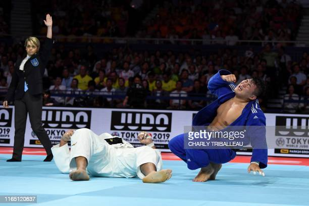 South Korea's Kim Minjung reacts after defeating Brazil's Rafael Silva in men's over 100kg category bronze medal match during the 2019 Judo World...