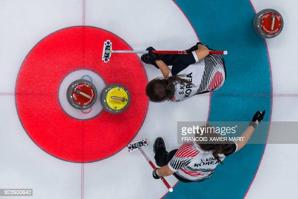 TOPSHOT South Korea's Kim Seonyeong and South Korea's Kim Yeongmi compete during the curling women's gold medal game between South Korea and Sweden...