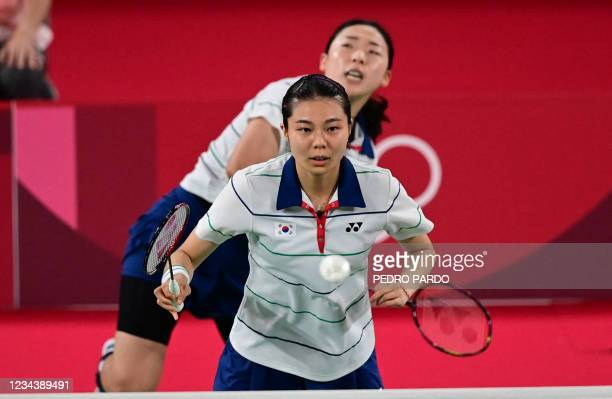 South Korea's Kim So-yeong looks on as South Korea's Kong Hee-yong hits a shot in their women's doubles badminton bronze medal match against South...