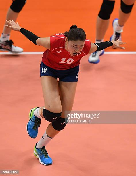 South Korea's Kim Yeon Koung celebrates winning a point during the women's qualifying volleyball match between Japan and South Korea at the...