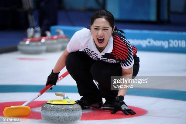 South Korea's Kim Yeongmi shouts during the curling women's round robin session between South Korea and the Olympic Athletes from Russia during the...