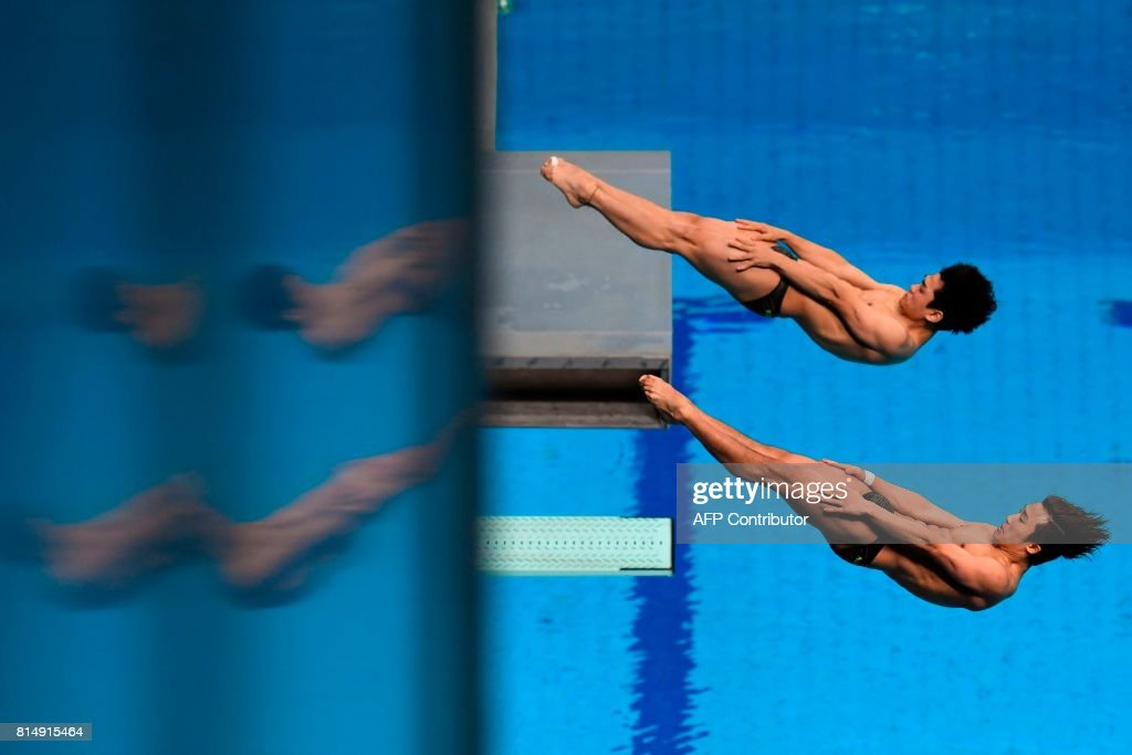 TOPSHOT - South Korea's Kim Yeongnam and South Korea's Woo Haram compete in the Men's 3m Synchro Springboard final during the diving competition at the 2017 FINA World Championships in Budapest, on July 15, 2017. /