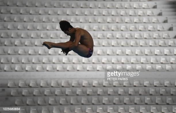 South Korea's Kim Yeongnam competes in the men's 10m platform diving preliminary during the 2018 Asian Games in Jakarta on September 1 2018