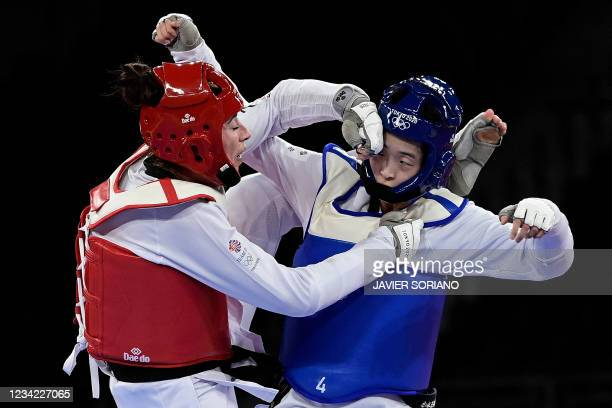 South Korea's Lee Da-bin and Britain's Bianca Walkden compete in the taekwondo women's +67kg semi-final bout during the Tokyo 2020 Olympic Games at...