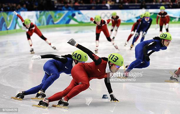 South Korea's Lee EunByul chases China's Zhang Hui in the Women's Short Track Speedskating 3000m Relay finals at the Pacific Coliseum in Vancouver...