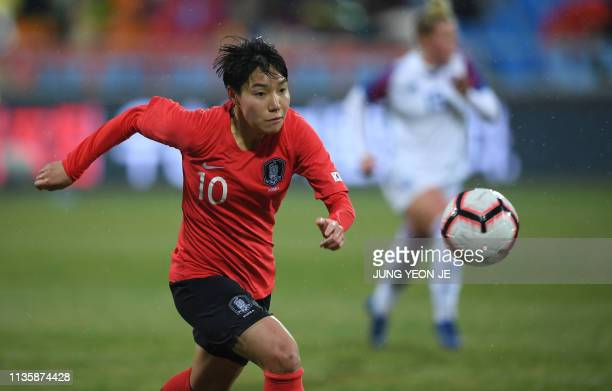 South Korea's Lee Geum-min dribbles the ball against Iceland during a women's friendly football match in Chuncheon on April 9, 2019.