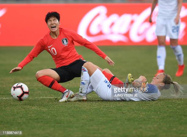 South Korea's Lee Geum-min fights for the ball with Iceland's Jonsdottir Gunnhildur Yrsa during a women's friendly football match in Chuncheon on...