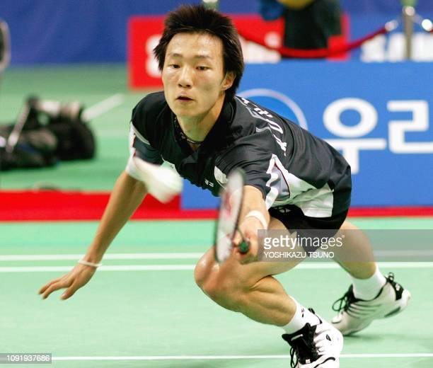 South Korea's Lee HyunIl dives for a return against Indonesia's Taufik Hidayat during their men's badminton singles final at the 14th Asian Games in...
