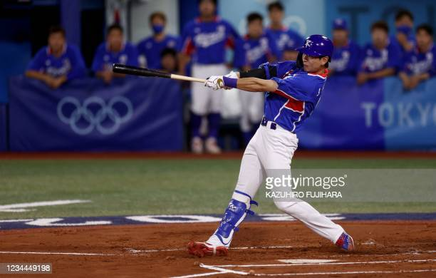 South Korea's Lee Jung-hoo hits a double to right field during the first inning of the Tokyo 2020 Olympic Games baseball semifinal game between South...