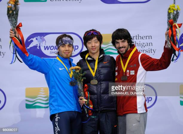 South Korea's Lee JungSu with gold US Apolo Anton Ohno with silver and Canada's Charles Hamelin with bronze celebrate on the winners' podium of the...