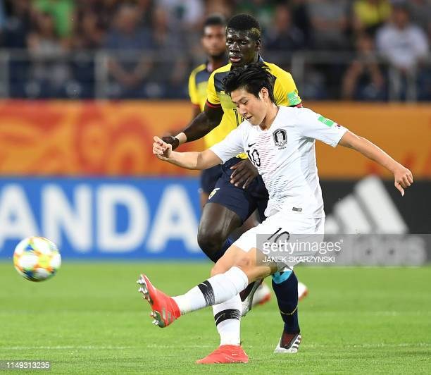 South Korea's Lee Kangin vies for the ball with Ecuador's Sergio Quintero during the U20 semifinal football match Ecuador against South Korea in...