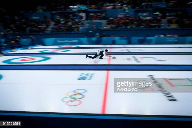 TOPSHOT South Korea's Lee Kijeong throws the stone during the curling mixed doubles round robin session between South Korea and Finland during the...