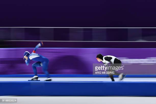 TOPSHOT South Korea's Lee SangHwa and Japan's Arisa Go compete in the women's 500m speed skating event during the Pyeongchang 2018 Winter Olympic...