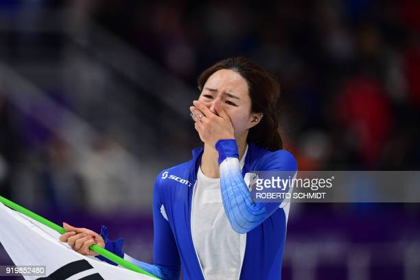 TOPSHOT South Korea's Lee SangHwa celebrates after the women's 500m speed skating event during the Pyeongchang 2018 Winter Olympic Games at the...